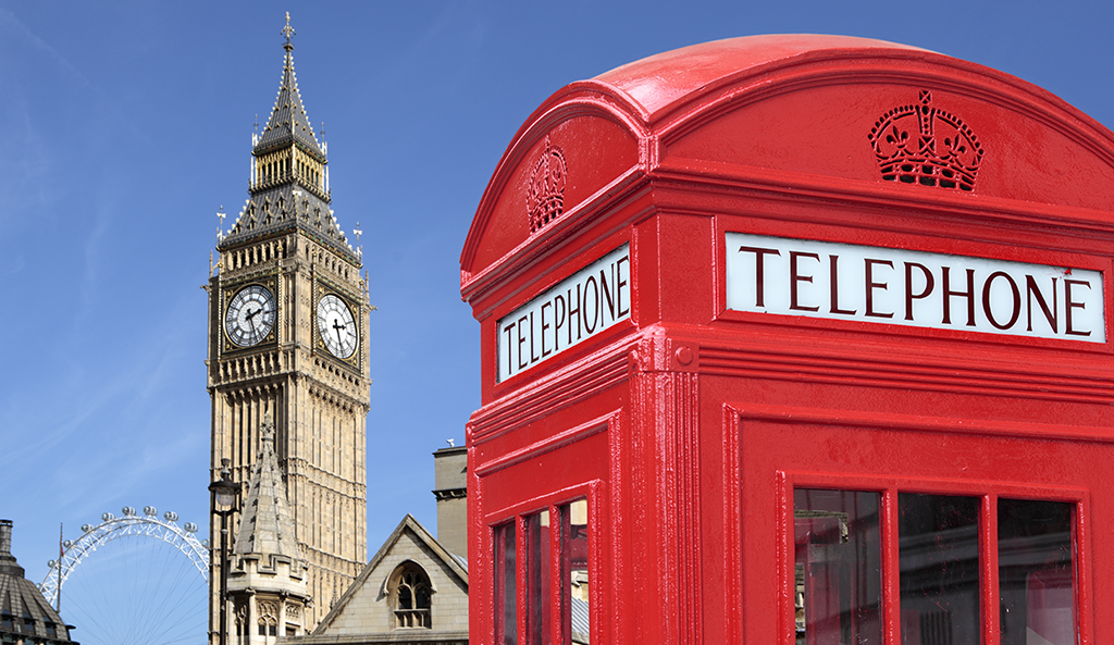 Photo with a typical red uk telephone booth with Big Ben in the background